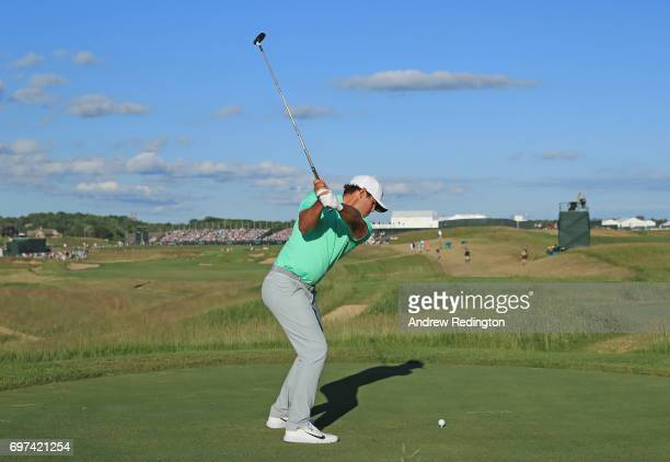 Brooks Koepka of the United States plays his shot from the 18th tee during the final round of the 2017 US Open at Erin Hills on June 18 2017 in...