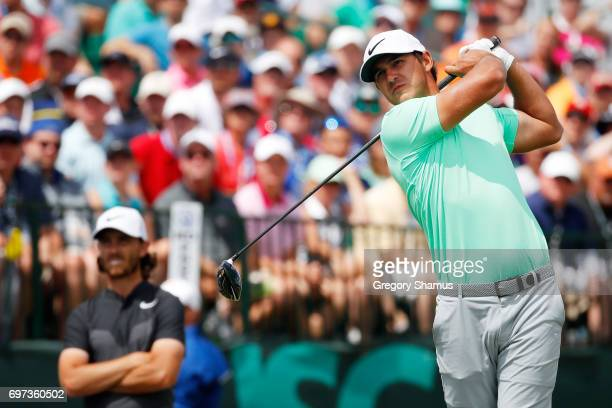 Brooks Koepka of the United States plays his shot from the first tee during the final round of the 2017 US Open at Erin Hills on June 18 2017 in...