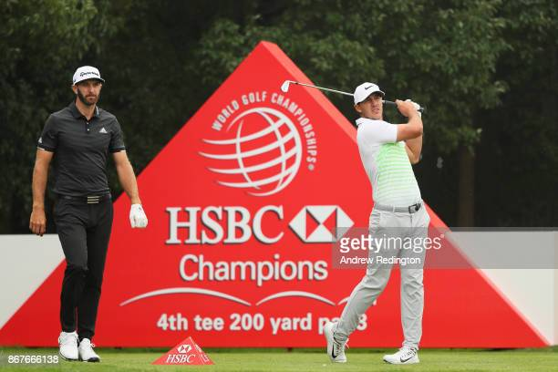 Brooks Koepka of the United States plays his shot from the fourth tee as Dustin Johnson of the United States looks on during the final round of the...