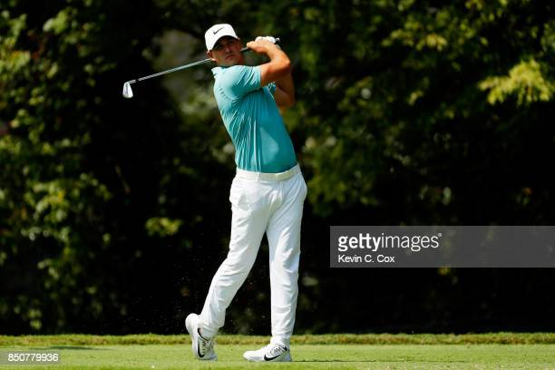 Brooks Koepka of the United States plays his shot from the second tee plays his shot from the second tee during the first round of the TOUR...