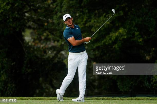 Brooks Koepka of the United States plays his shot from the second tee during the final round of the TOUR Championship at East Lake Golf Club on...