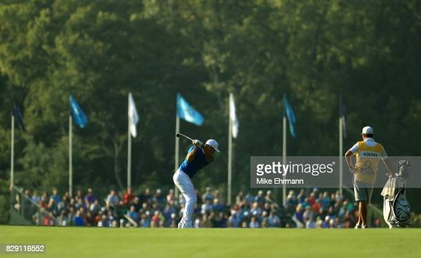 Brooks Koepka of the United States plays his shot on the 10th hole during the first round of the 2017 PGA Championship at Quail Hollow Club on August...