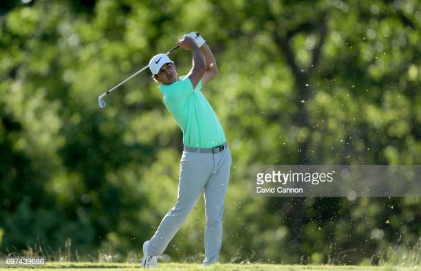 Brooks Koepka of the United States plays his tee shot at the par 3 16th hole during the final round of the 117th US Open Championship at Erin Hills...