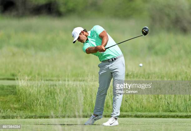 Brooks Koepka of the United States plays his tee shot at the par 4 second hole during the final round of the 117th US Open Championship at Erin Hills...