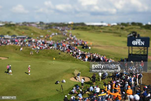 Brooks Koepka of the United States plays out of a bunker on the 7th hole during the third round of the 146th Open Championship at Royal Birkdale on...