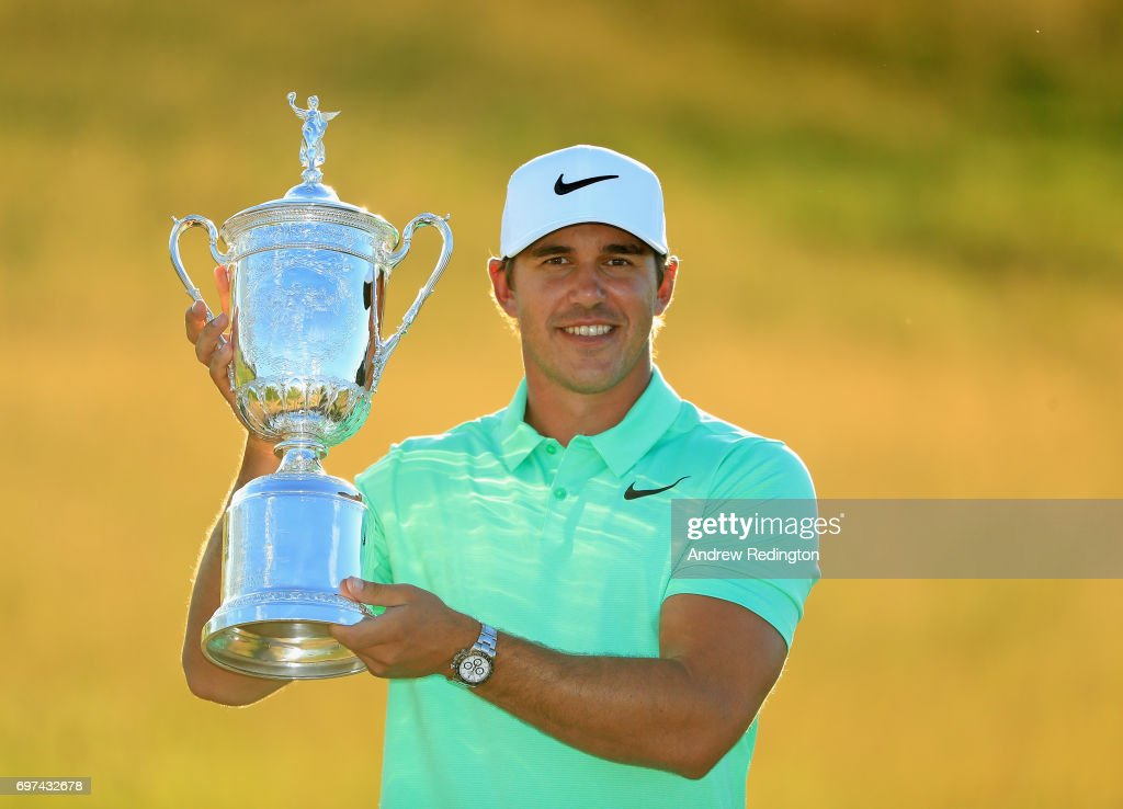 Brooks Koepka of the United States poses with the winner's trophy after his victory at the 2017 U.S. Open at Erin Hills on June 18, 2017 in Hartford, Wisconsin.
