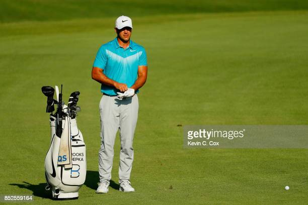 Brooks Koepka of the United States pprepares to play 16h during the third round of the TOUR Championship at East Lake Golf Club on September 23 2017...