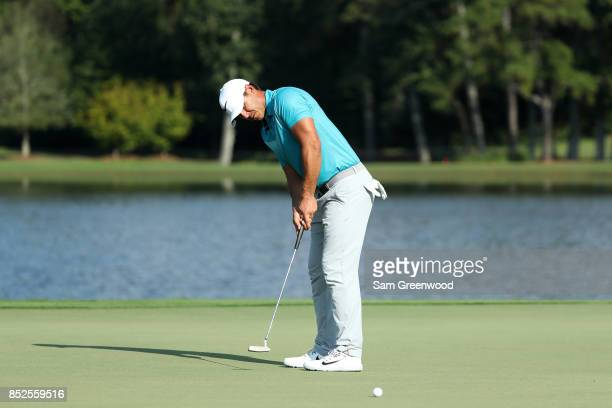 Brooks Koepka of the United States putts on the 15th green during the third round of the TOUR Championship at East Lake Golf Club on September 23...