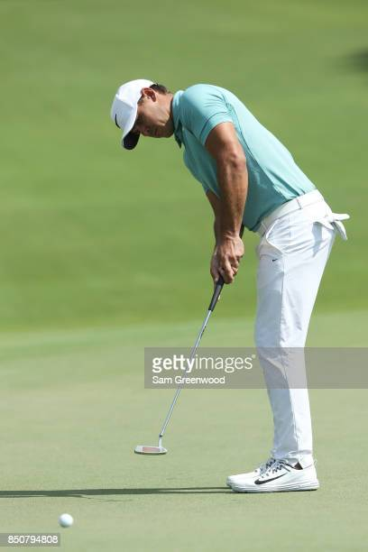 Brooks Koepka of the United States putts on the seventh green during the first round of the TOUR Championship at East Lake Golf Club on September 21...