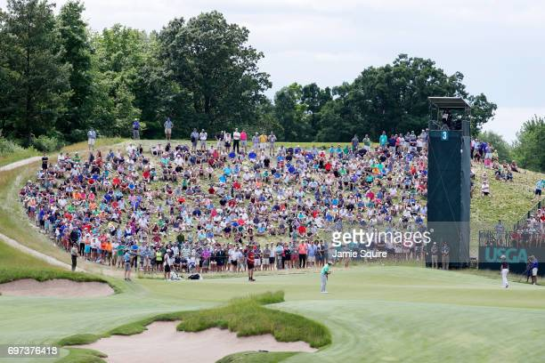 Brooks Koepka of the United States putts on the third green during the final round of the 2017 US Open at Erin Hills on June 18 2017 in Hartford...