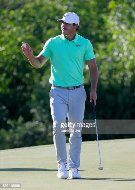 Brooks Koepka of the United States reacts after making a birdie on the 15th green during the final round of the 2017 US Open at Erin Hills on June 18...