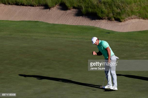 Brooks Koepka of the United States reacts after making a birdie on the 16th green during the final round of the 2017 US Open at Erin Hills on June 18...