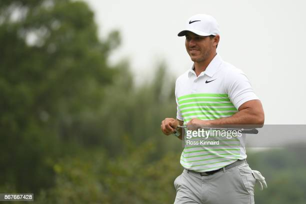 Brooks Koepka of the United States reacts on the 13th green during the final round of the WGC HSBC Champions at Sheshan International Golf Club on...