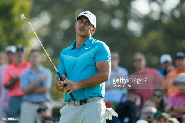 Brooks Koepka of the United States reacts on the 16th green during the third round of the TOUR Championship at East Lake Golf Club on September 23...