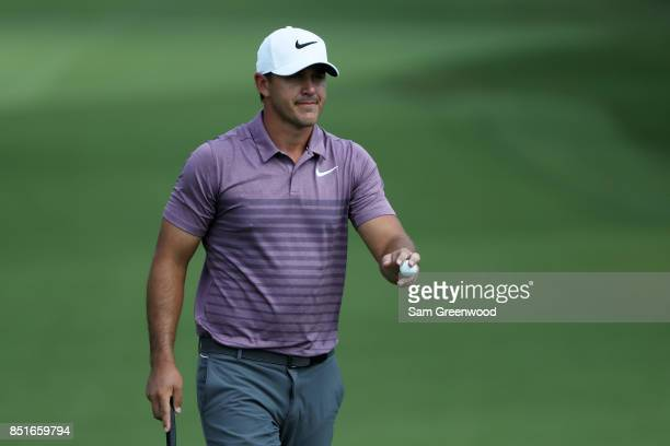 Brooks Koepka of the United States reacts on the seventh green during the second round of the TOUR Championship at East Lake Golf Club on September...