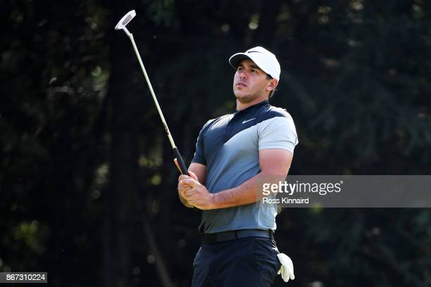 Brooks Koepka of the United States reacts to a missed putt on the seventh hole during the third round of the WGC HSBC Champions at Sheshan...
