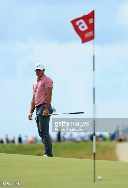 Brooks Koepka of the United States reacts to his shot on the sixth green during the third round of the 2017 US Open at Erin Hills on June 17 2017 in...