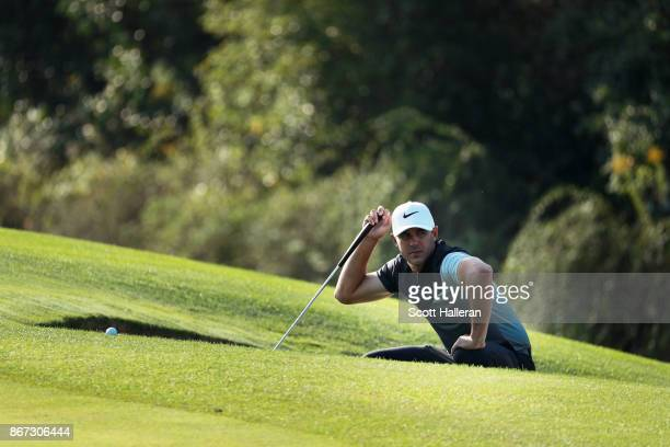 Brooks Koepka of the United States waits on the 14th hole during the third round of the WGC HSBC Champions at Sheshan International Golf Club on...