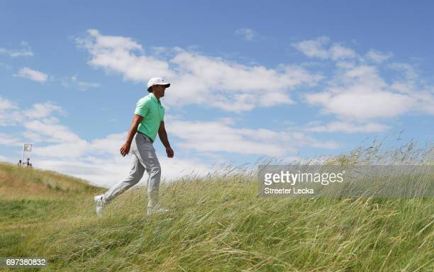 Brooks Koepka of the United States walks across the fifth hole during the final round of the 2017 US Open at Erin Hills on June 18 2017 in Hartford...