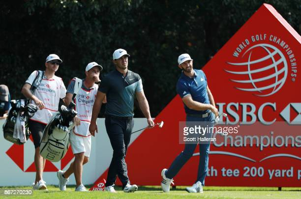 Brooks Koepka of the United States walks from the fourth tee as Dustin Johnson of the United States watches his shot during the third round of the...