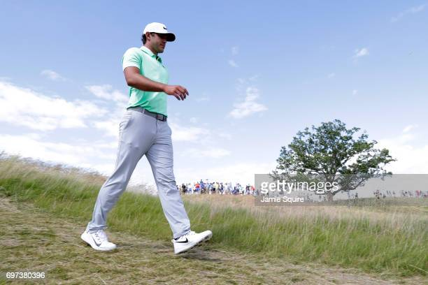 Brooks Koepka of the United States walks off the fifth hole during the final round of the 2017 US Open at Erin Hills on June 18 2017 in Hartford...