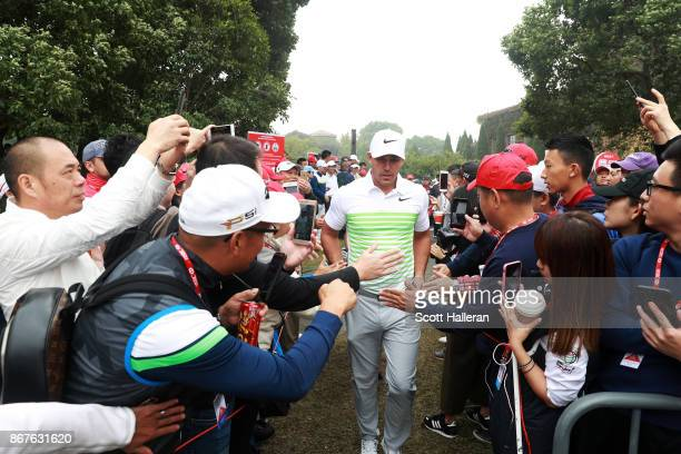 Brooks Koepka of the United States walks to the first tee during the final round of the WGC HSBC Champions at Sheshan International Golf Club on...