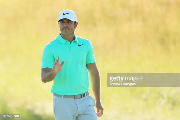 Brooks Koepka of the United States waves to the crowd during the final round of the 2017 US Open at Erin Hills on June 18 2017 in Hartford Wisconsin