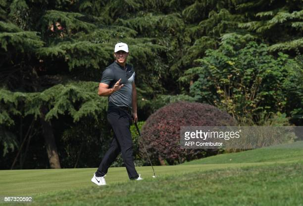 Brooks Koepka of the US acknowledges the crowd during the third round of the WGCHSBC Champions at the Sheshan International golf club in Shanghai on...
