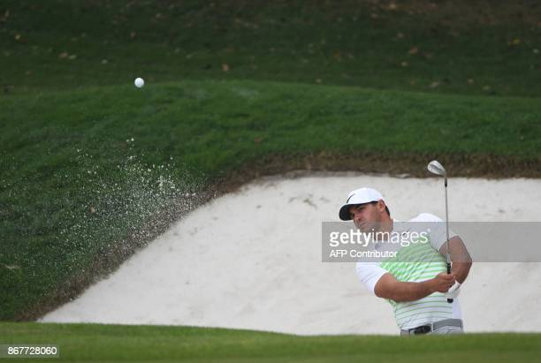 Brooks Koepka of the US hits a bunker shot during the final round of the 975 million USD WGCHSBC Champions at the Sheshan International golf club in...
