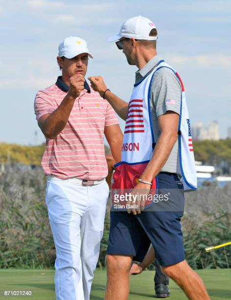 Brooks Koepka of the US Team and Austin Johnson of the US Team fist pump during the second round of the Presidents Cup at Liberty National Golf Club...