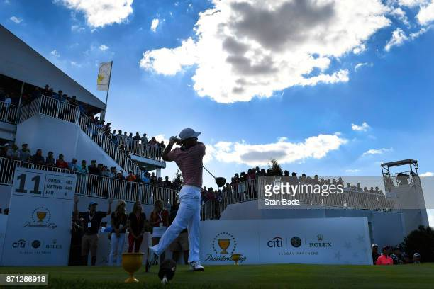 Brooks Koepka of the US team plays a tee shot on the 11th hole during the second round of the Presidents Cup at Liberty National Golf Club on...