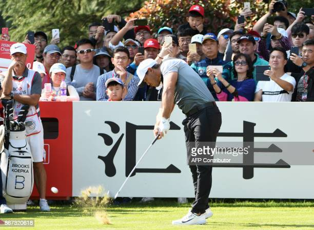 Brooks Koepka of the US tees off during the third round of the WGCHSBC Champions at the Sheshan International golf club in Shanghai on October 28...