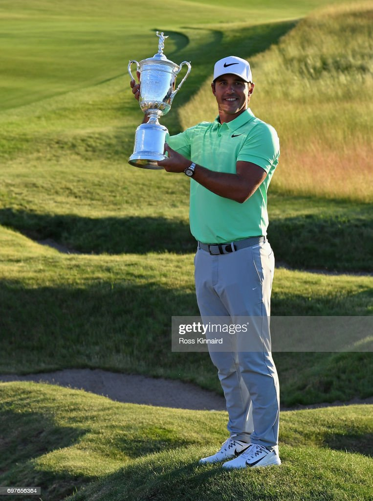 Brooks Koepka of the USA celebrates with the champions trophy after the final round of the 2017 U.S. Open at Erin Hills golf club in Hartford, Wisconsin on June 18, 2017 in Hartford, Wisconsin.