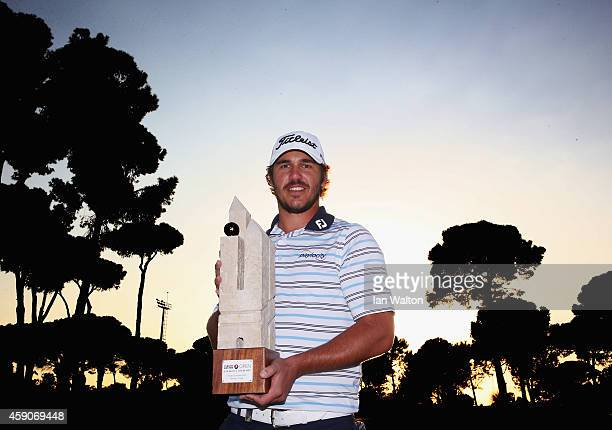 Brooks Koepka of the USA celebrates with the trophy after winning the final round of the 2014 Turkish Airlines Open at The Montgomerie Maxx Royal on...