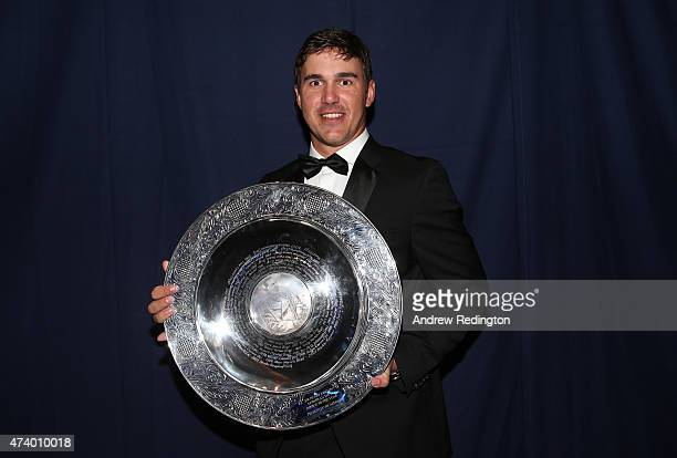 Brooks Koepka of the USA poses with the Rookie of the Year award during the European Tour Players' Awards ahead of the BMW PGA Championship at the...