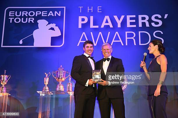 Brooks Koepka of the USA receives the Challenge Tour Graduate of the Year award from Alain De Soultrait the Challenge Tour Director during the...