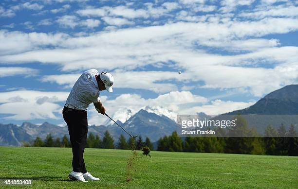 Brooks Koepka of USA plays a shot during the final round of the Omega European Masters at CranssurSierre Golf Club on September 7 2014 in...