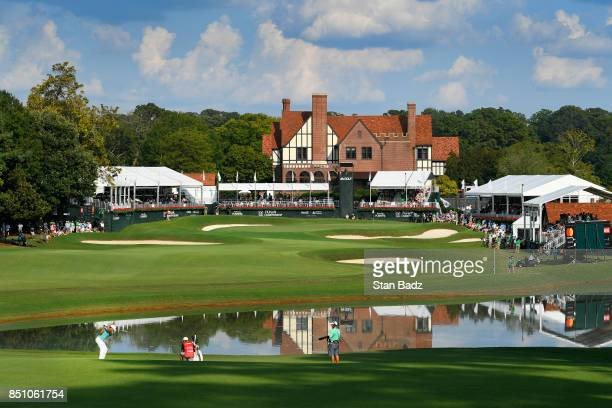 Brooks Koepka plays a shot on the 18th hole during the first round of the TOUR Championship the final event of the FedExCup Playoffs at East Lake...