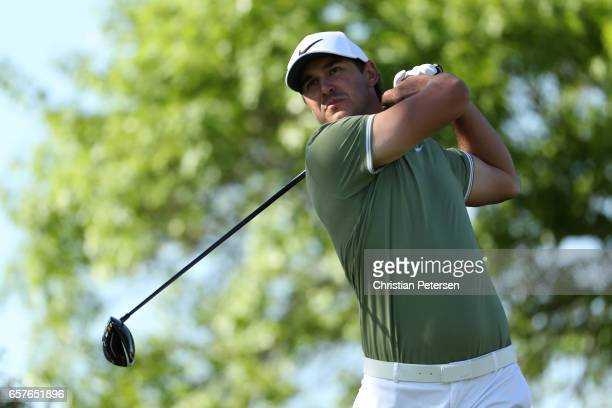 Brooks Koepka tees off on the 6th hole of his match during round four of the World Golf ChampionshipsDell Technologies Match Play at the Austin...