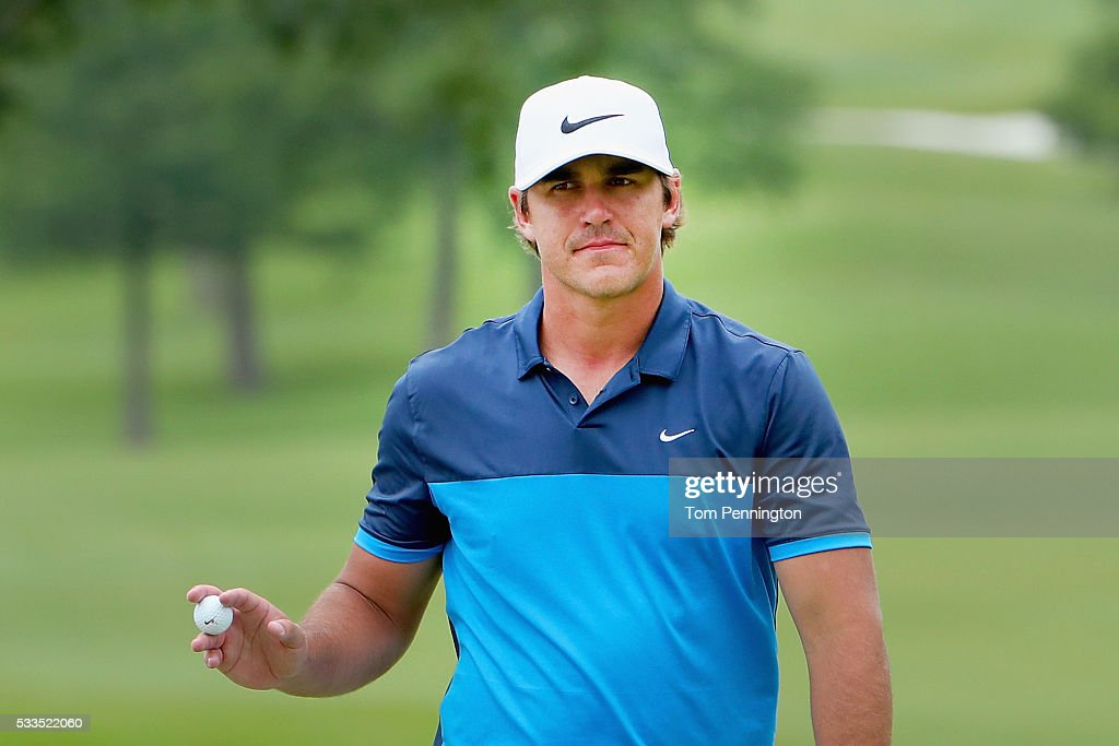 Brooks Koepka waves to the gallery on the eighth green during the Final Round at ATT Byron Nelson on May 22 2016 in Irving Texas