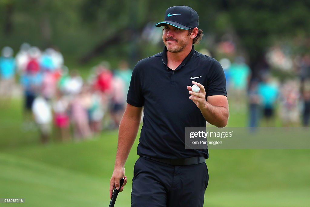 Brooks Koepka waves to the gallery on the tenth green during Round Three at the AT&T Byron Nelson on May 21, 2016 in Irving, Texas.