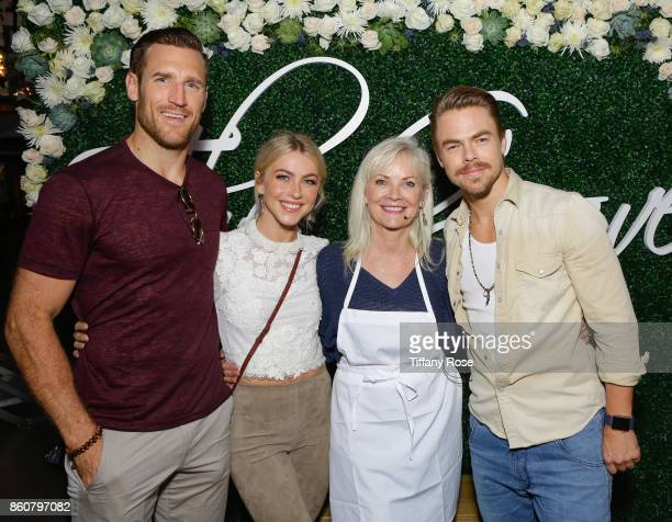 Brooks Laich Julianne Hough Marriann Nelson and Derek Hough attend the Paint Sip Help event to Benefit Children's Hospital Los Angeles hosted by The...