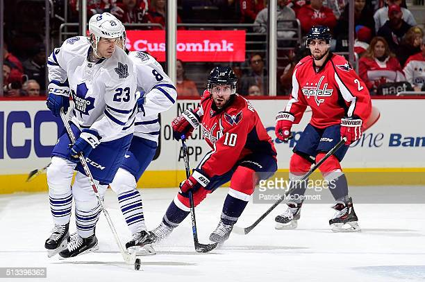 Brooks Laich of the Toronto Maple Leafs skates with the puck in the first period during their game against the Washington Capitals at Verizon Center...