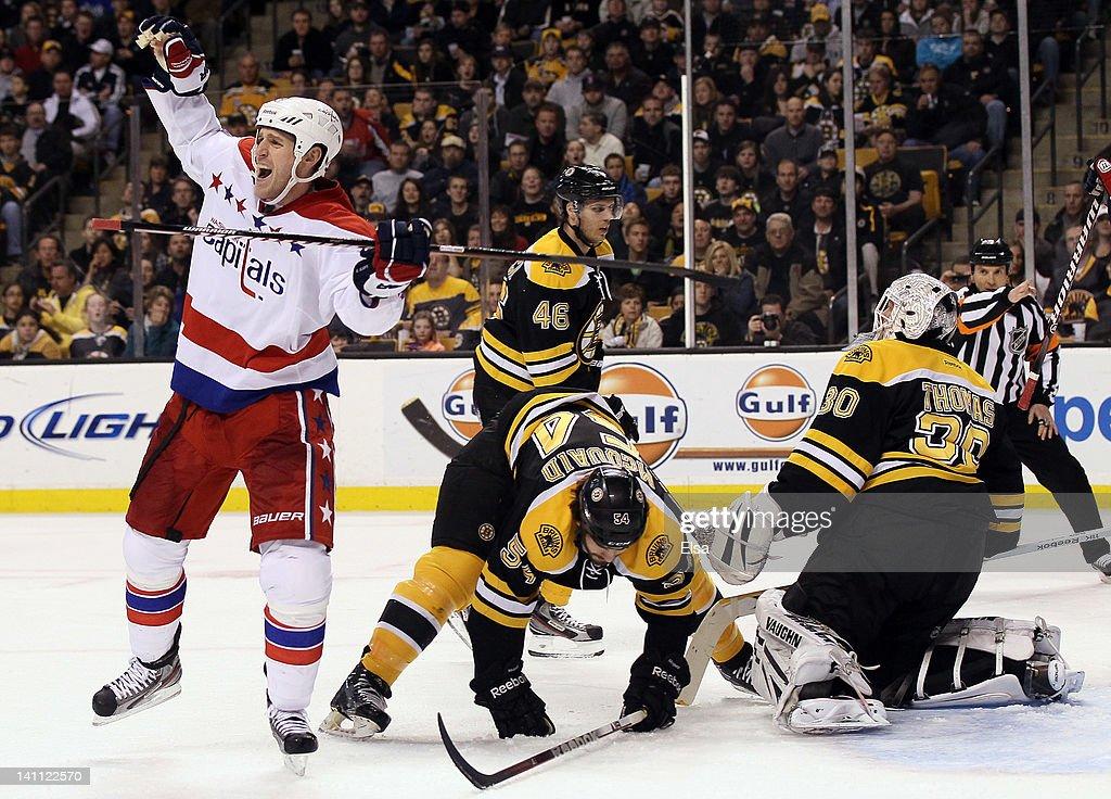 Brooks Laich of the Washington Capitals celebrates his goal in the second period as Adam McQuaidTim Thomas and David Krejci of the Boston Bruins...