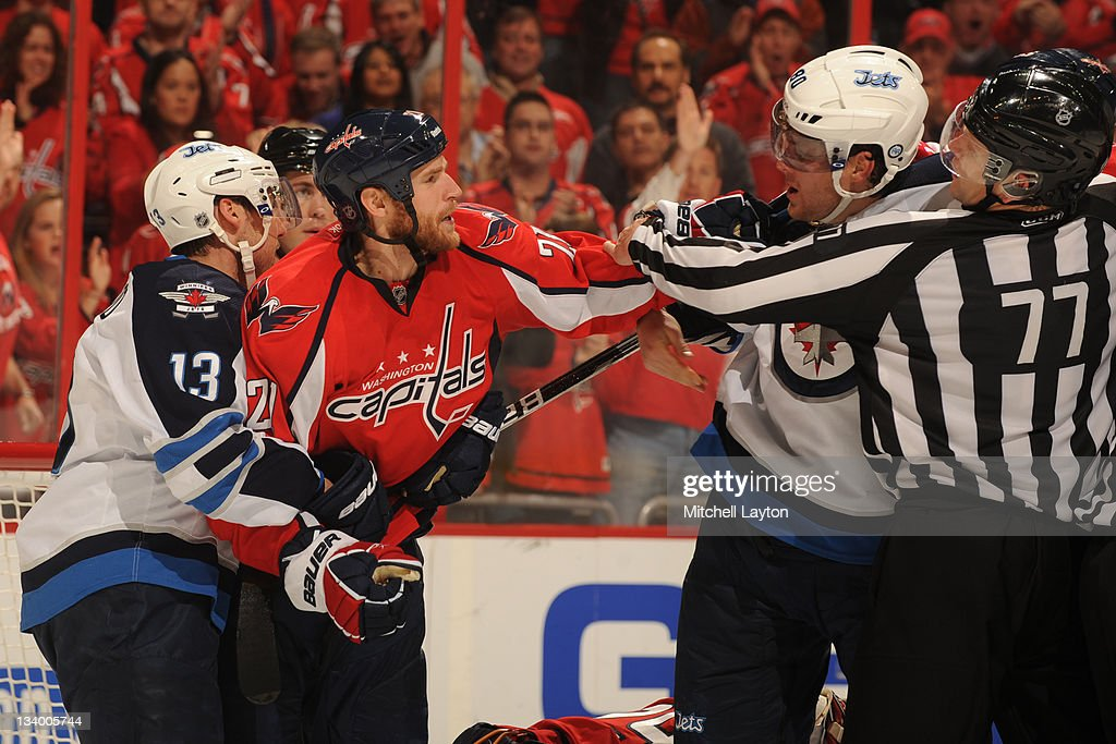 <a gi-track='captionPersonalityLinkClicked' href=/galleries/search?phrase=Brooks+Laich&family=editorial&specificpeople=554432 ng-click='$event.stopPropagation()'>Brooks Laich</a> #21 of the Washington Capitals fights <a gi-track='captionPersonalityLinkClicked' href=/galleries/search?phrase=Nik+Antropov&family=editorial&specificpeople=202953 ng-click='$event.stopPropagation()'>Nik Antropov</a> #80 of the Winnipeg Jets during a NHL hockey game on November 23, 2011 at the Verizon Center in Washington, DC.