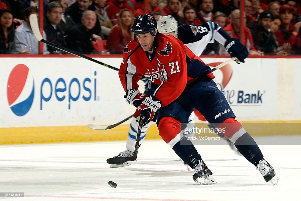 <a gi-track='captionPersonalityLinkClicked' href=/galleries/search?phrase=Brooks+Laich&family=editorial&specificpeople=554432 ng-click='$event.stopPropagation()'>Brooks Laich</a> #21 of the Washington Capitals moves the puck up ice in the second period during an NHL game against the Winnipeg Jets at Verizon Center on February 6, 2014 in Washington, DC.