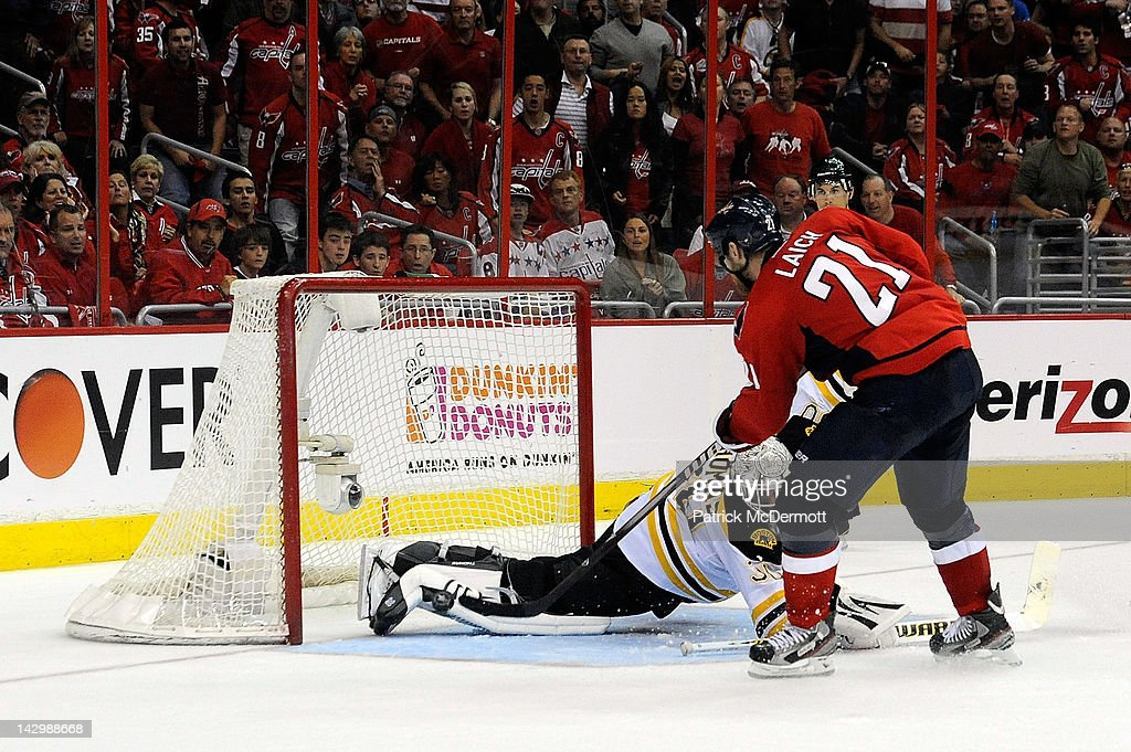 <a gi-track='captionPersonalityLinkClicked' href=/galleries/search?phrase=Brooks+Laich&family=editorial&specificpeople=554432 ng-click='$event.stopPropagation()'>Brooks Laich</a> #21 of the Washington Capitals scores a goal against Tim Thomas #30 of the Boston Bruins in Game Three of the Eastern Conference Quarterfinals during the 2012 NHL Stanley Cup Playoffs at Verizon Center on April 16, 2012 in Washington, DC.
