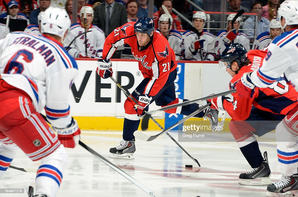 <a gi-track='captionPersonalityLinkClicked' href=/galleries/search?phrase=Brooks+Laich&family=editorial&specificpeople=554432 ng-click='$event.stopPropagation()'>Brooks Laich</a> #21 of the Washington Capitals shoots the puck in the third period against the New York Rangers at the Verizon Center on October 16, 2013 in Washington, DC.