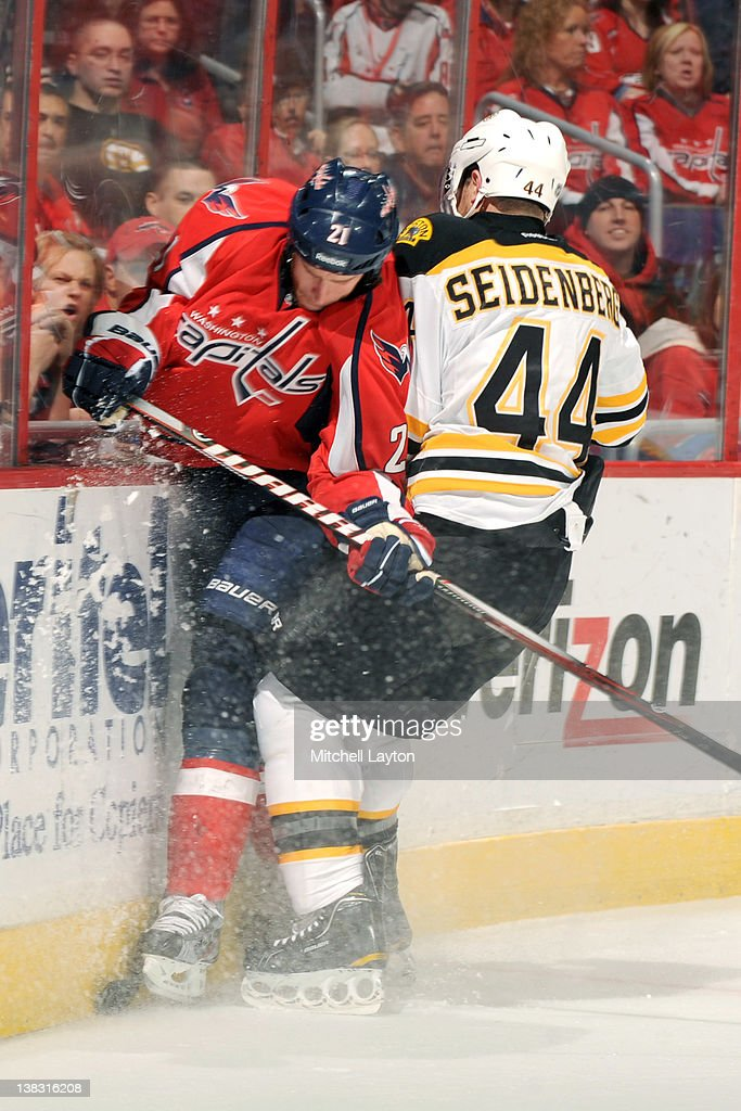 <a gi-track='captionPersonalityLinkClicked' href=/galleries/search?phrase=Brooks+Laich&family=editorial&specificpeople=554432 ng-click='$event.stopPropagation()'>Brooks Laich</a> #21 of the Washington Capitals takes a hit from <a gi-track='captionPersonalityLinkClicked' href=/galleries/search?phrase=Dennis+Seidenberg&family=editorial&specificpeople=204616 ng-click='$event.stopPropagation()'>Dennis Seidenberg</a> #44 of the Boston Bruins during an NHL hockey game on February 5, 2012 at the Verizon Center in Washington, DC.