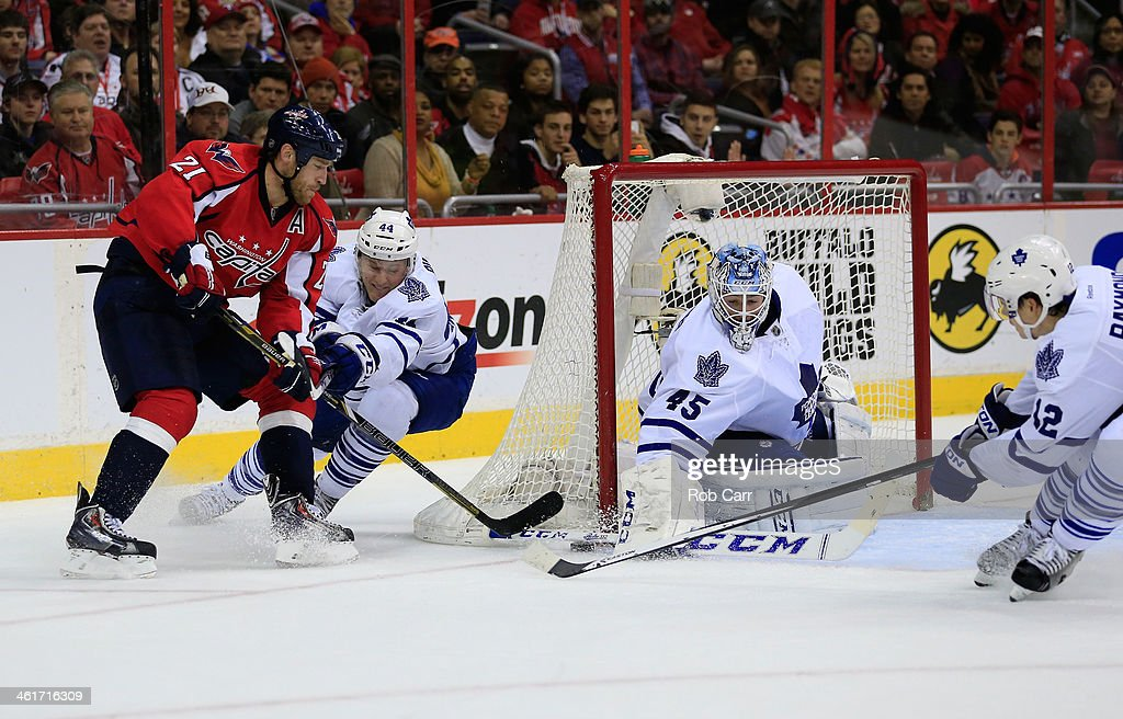 <a gi-track='captionPersonalityLinkClicked' href=/galleries/search?phrase=Brooks+Laich&family=editorial&specificpeople=554432 ng-click='$event.stopPropagation()'>Brooks Laich</a> #21 of the Washington Capitals works the puck in front of <a gi-track='captionPersonalityLinkClicked' href=/galleries/search?phrase=Morgan+Rielly&family=editorial&specificpeople=8050727 ng-click='$event.stopPropagation()'>Morgan Rielly</a> #44 and goalie <a gi-track='captionPersonalityLinkClicked' href=/galleries/search?phrase=Jonathan+Bernier&family=editorial&specificpeople=540491 ng-click='$event.stopPropagation()'>Jonathan Bernier</a> #45 of the Toronto Maple Leafs during the third period of the Capitals 3-2 win at Verizon Center on January 10, 2014 in Washington, DC.
